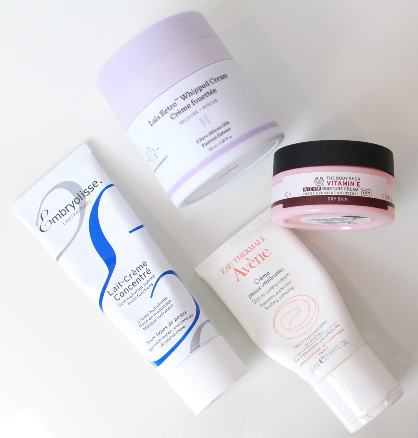 The Body Shop Vitamin E Intense Moisture Cream, Drunk Elephant Lala Retro Whipped Cream, Avene Skin Recovery Cream, Embryolisse Lait-Creme Concentre