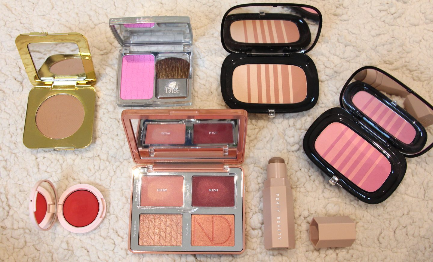 Tom Ford Soleil Glow Bronzer in Terra, Dior Diorskin Rosy Glow Healthy glow booster blush 001 petal, Marc Jacobs Air Blush Soft Glow Duo in Flesh and Fantasy and Lush and Libido, Jillian Dempsey Cheek Tint in Scarlet, Natasha Denona Bloom palette, Fenty Beauty Matte Skinstick in Amber