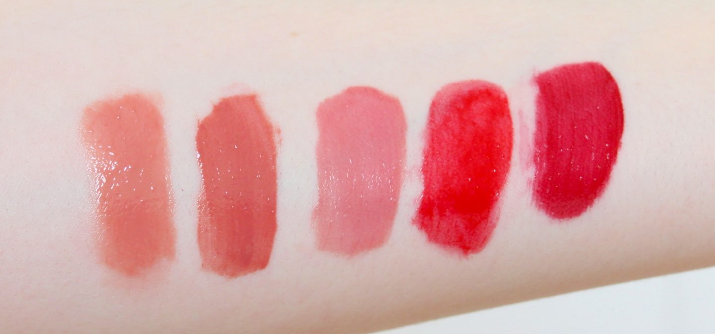 Lip Lacquer shade arm swatches: Lancome l'absolu lacquer in 134 and 202, Armani ecstasy mirror in 101, 400, and 502