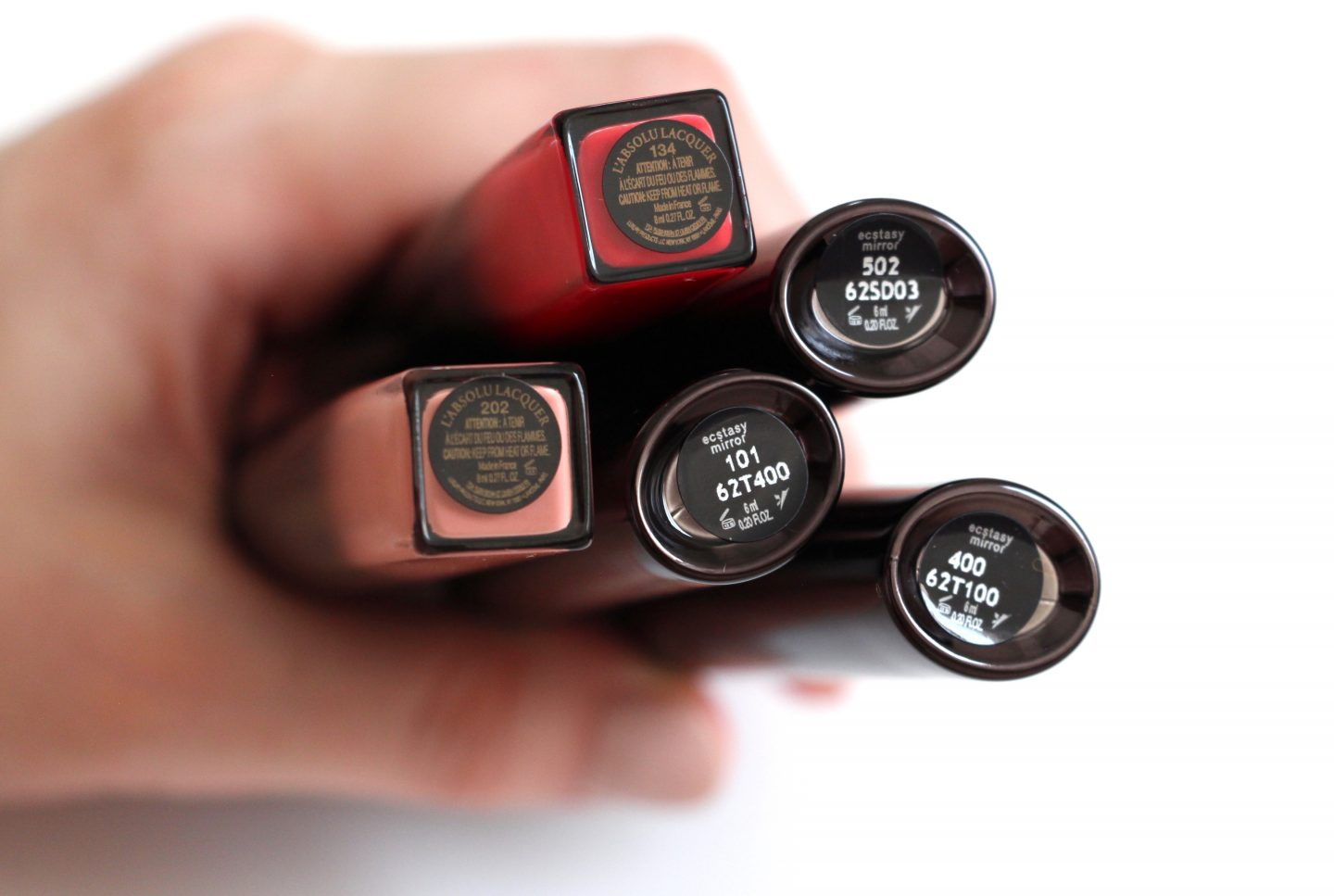 Lip Lacquers: Lancome l'absolu lacquer in 134 and 202, Armani ecstasy mirror in 101, 400, and 502